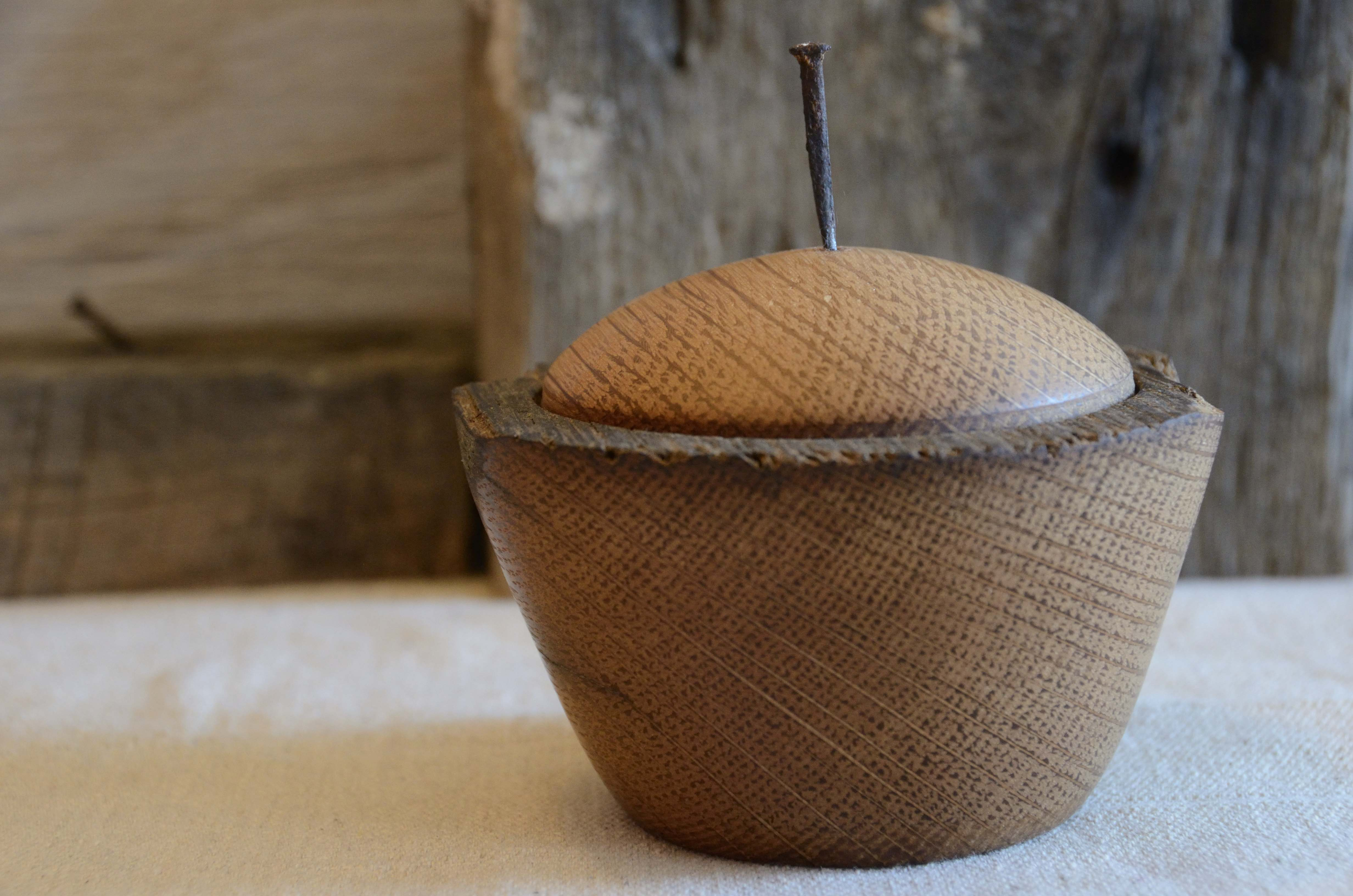 woodturned lidded vessel made of oak from a 100-year-old barn.