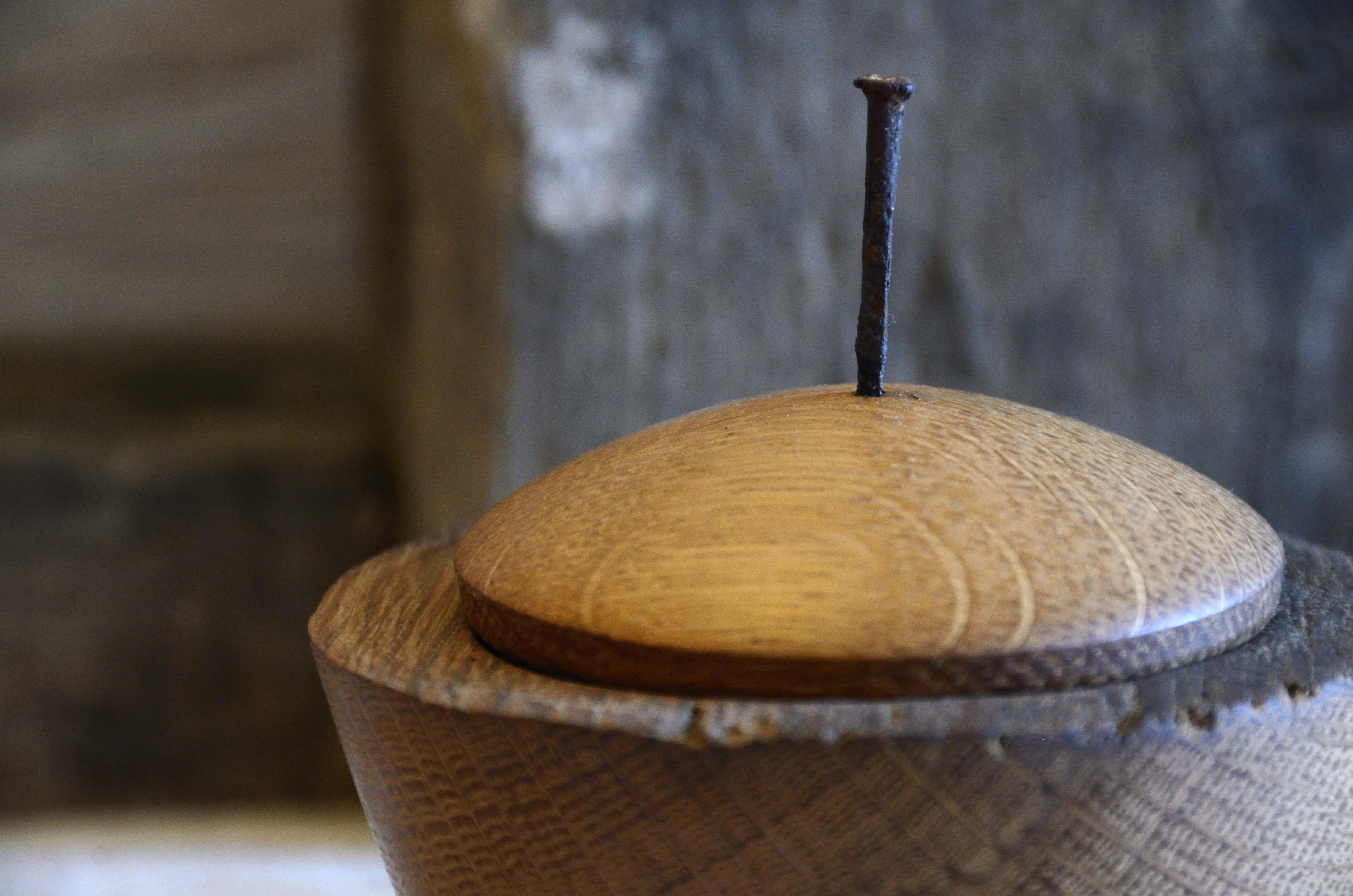 lidded vessel handcrafted on lathe with antique nail finial