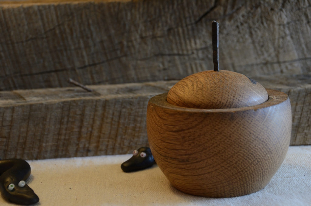 Old oak barn beam becomes beautiful handmade, turned lidded vessel with antique nail finial.